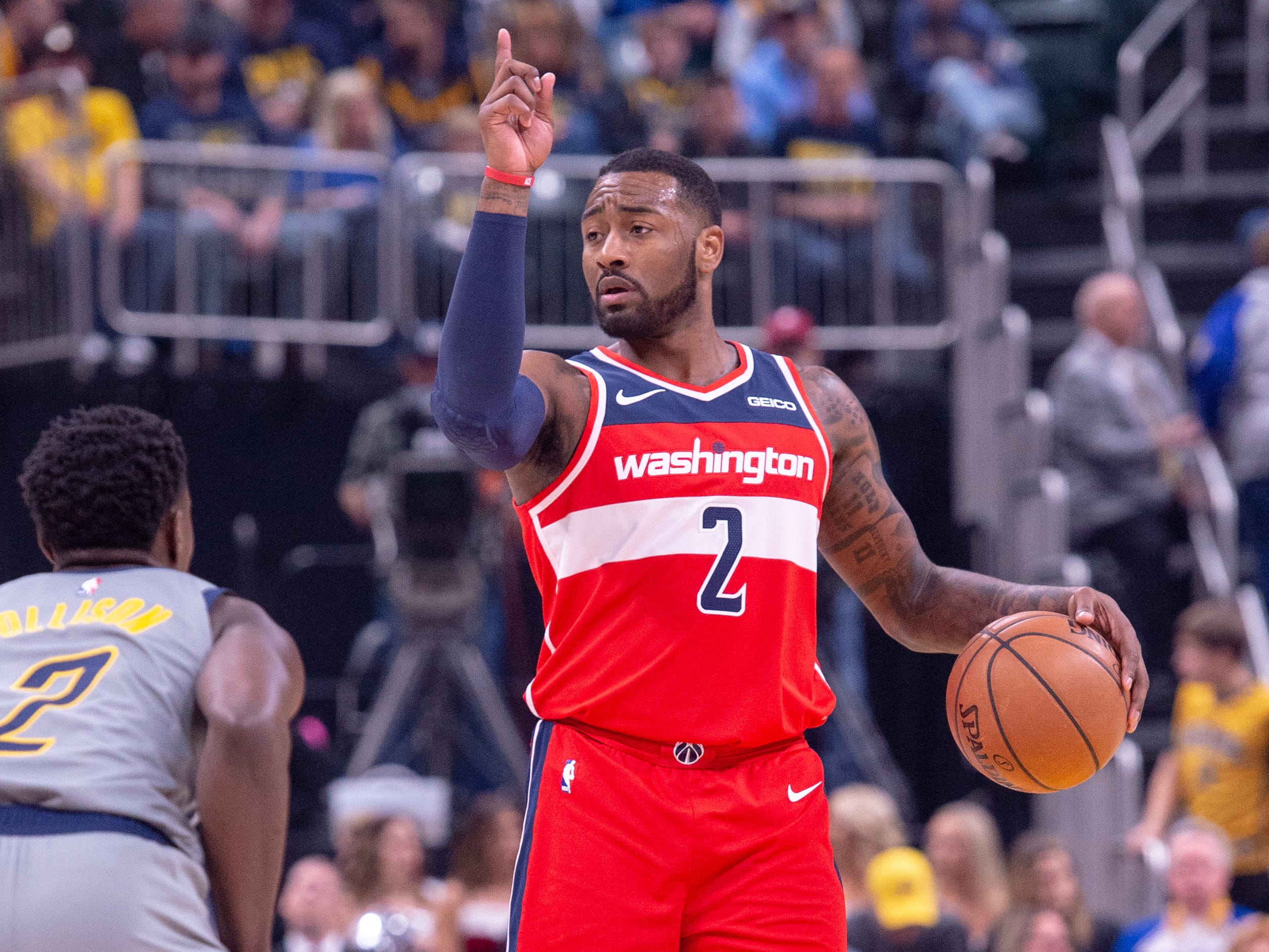 Washington Wizards guard John Wall (2) brings the ball up court during an NBA basketball game, Sunday, Dec. 23, 2018, in Indianapolis. Indiana Pacers won, 105-89.