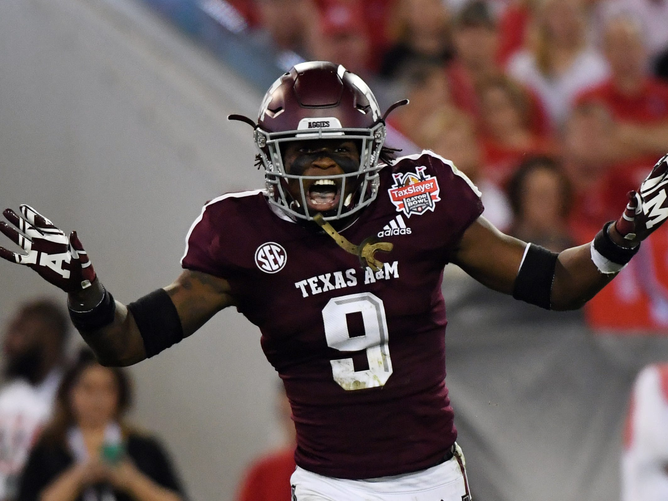 Texas A&M Aggies defensive back Leon O'Neal Jr. (9) reacts after a play against the North Carolina State Wolfpack during the first quarter of the Gator Bowl.