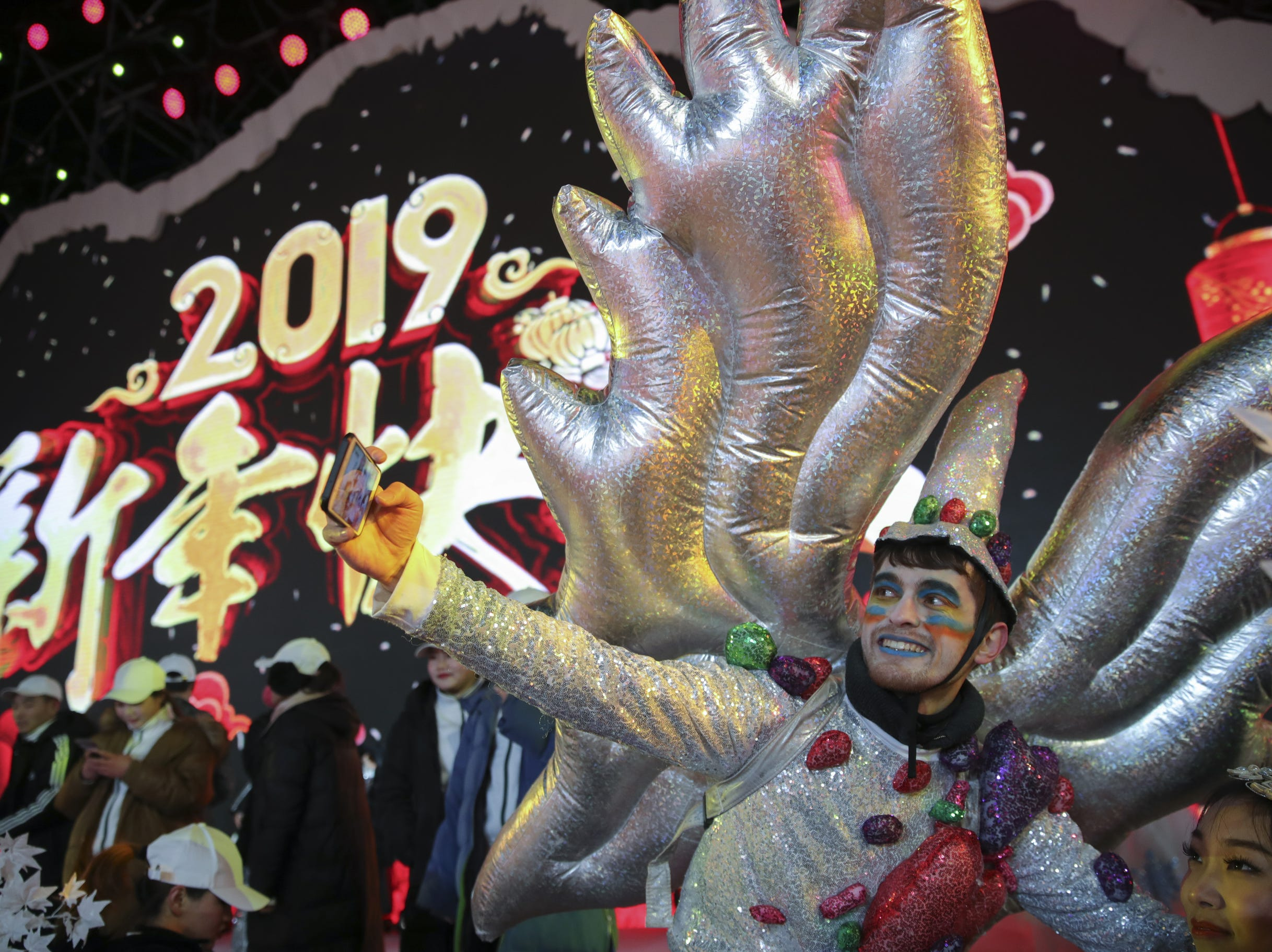 Chinese people celebrate the New Year during the New Year's Eve in Beijing, China.