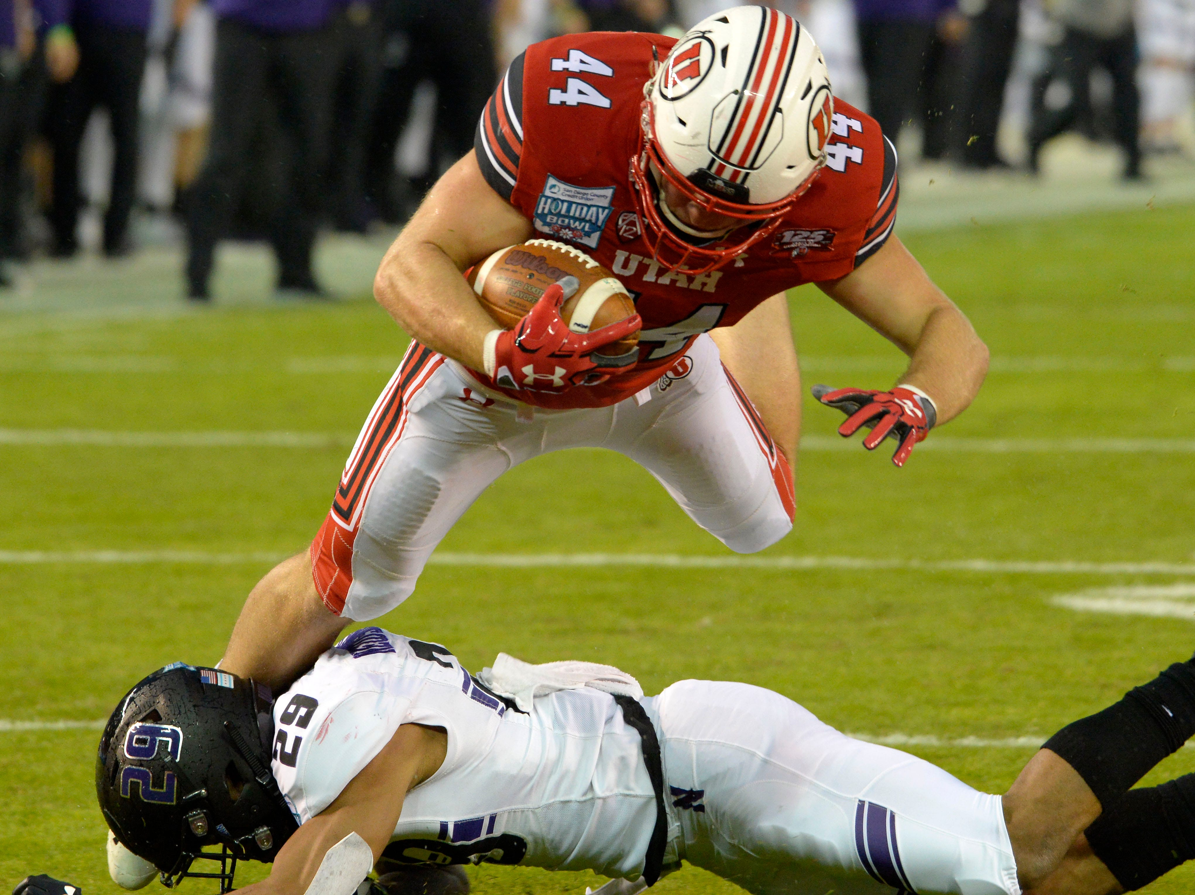 Utah Utes tight end Jake Jackson (44) scores a touchdown as Northwestern Wildcats defensive back Greg Newsome II (29) defends during the first quarter in the Holiday Bowl.