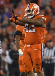 Clemson defensive lineman Christian Wilkins (42) reacts after sacking South Carolina quarterback Jake Bentley (19) during the 3rd quarter Saturday, November 14, 2018 at Clemson's Memorial Stadium.