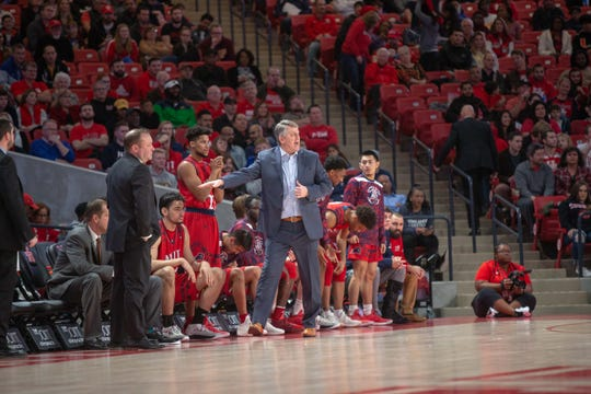 NJIT basketball coach Brian Kennedy directs his players during a recent road game.