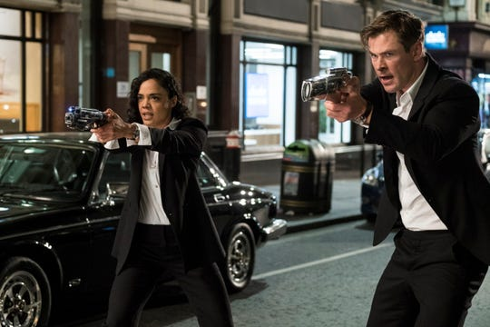 "Em (Tessa Thompson), left, and H (Chris Hemsworth) in Columbia Pictures' ""Men in Black International."""