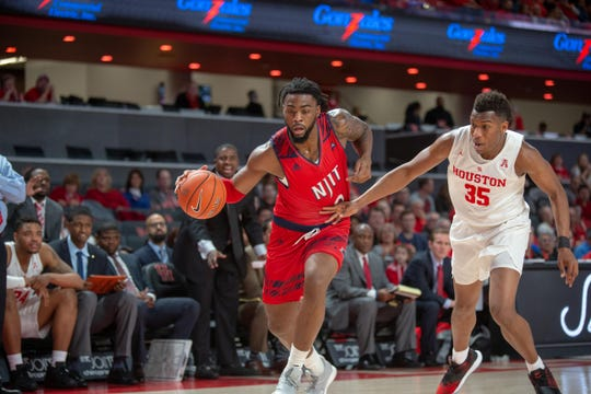 NJIT big man Abdul Lewis drives against Houston