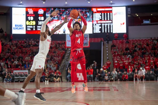 NJIT guard Zach Cooks shoots against Houston