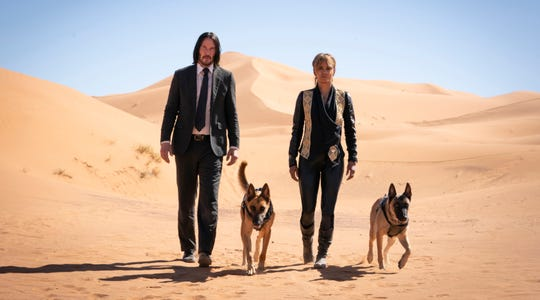 """John (Keanu Reeves) and Sofia (Halle Berry) in """"John Wick: Chapter 3."""""""