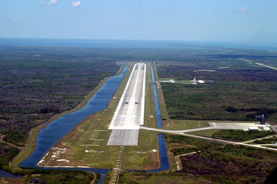 This 2015 aerial photo shows the runway at the Kennedy Space Center's former Shuttle Landing Facility. Longer and wider than most commercial runways, it is 15,000 feet long, with 1,000-foot paved overruns on each end, and 300 feet wide, with 50-foot asphalt shoulders. Used by military and civilian cargo carriers, astronauts' T-38 trainers, Shuttle Training Aircraft and helicopters as well as the space shuttle, the runway is now managed by Space Florida as a commercial spaceport.