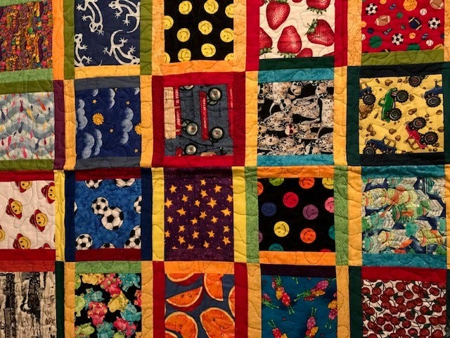 This quiet-looking quilt is a Talking Quilt.It is another mode for storytelling and was made by Mary Lee's late sister Linda Mathisen.