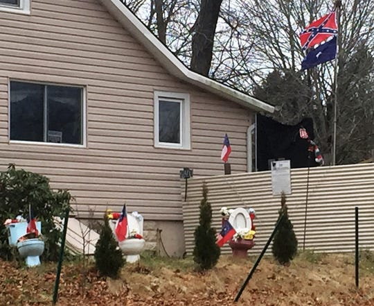 A Winslow resident contends his civil rights were violated when he was cited for a display of toilets outside his home.