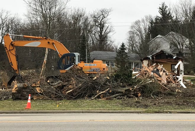Work began recently to demolish a house and remove some trees on the Western Avenue property to the east of Casa Del Taco that will become a Captain D's seafood restaurant this year.