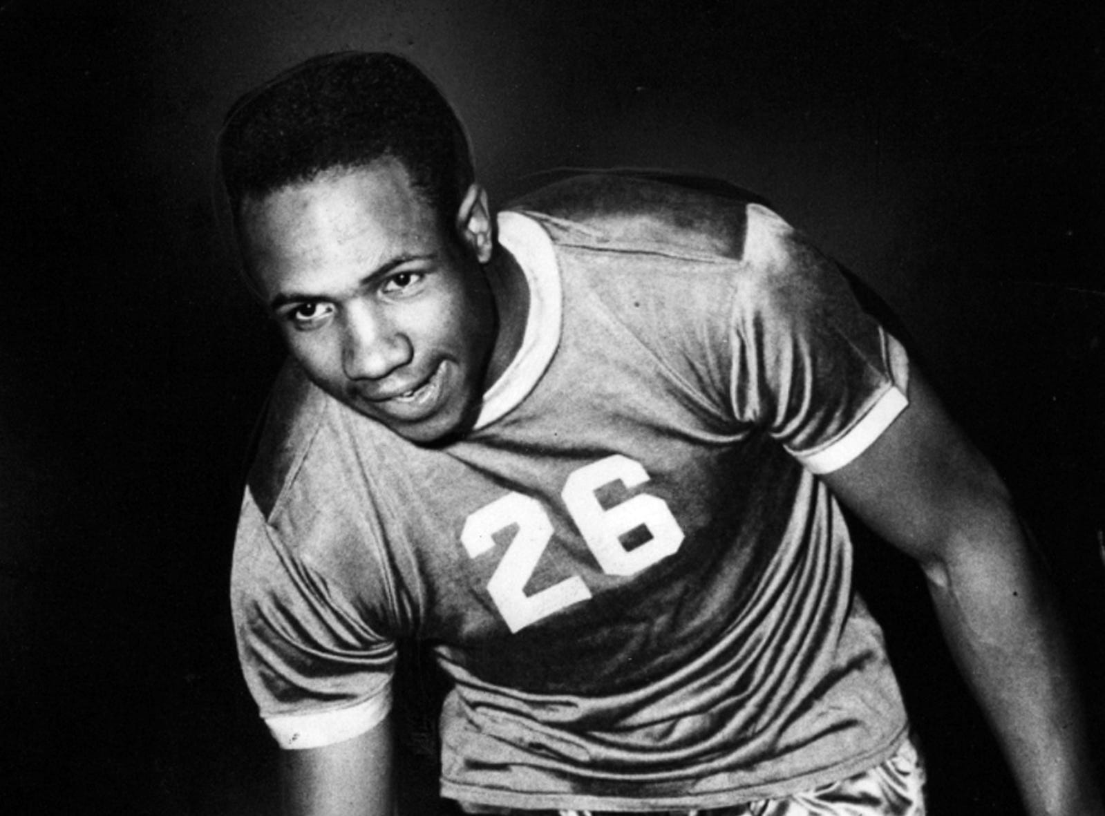 Cincinnati Reds rookie Frank Robinson is shown on the basketball court.