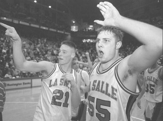 La Salle's Dave Esterkamp, left, and Roman Welter celebrate their Division I semifinal win over St. Edward Friday, March 22, 1996, in Columbus.