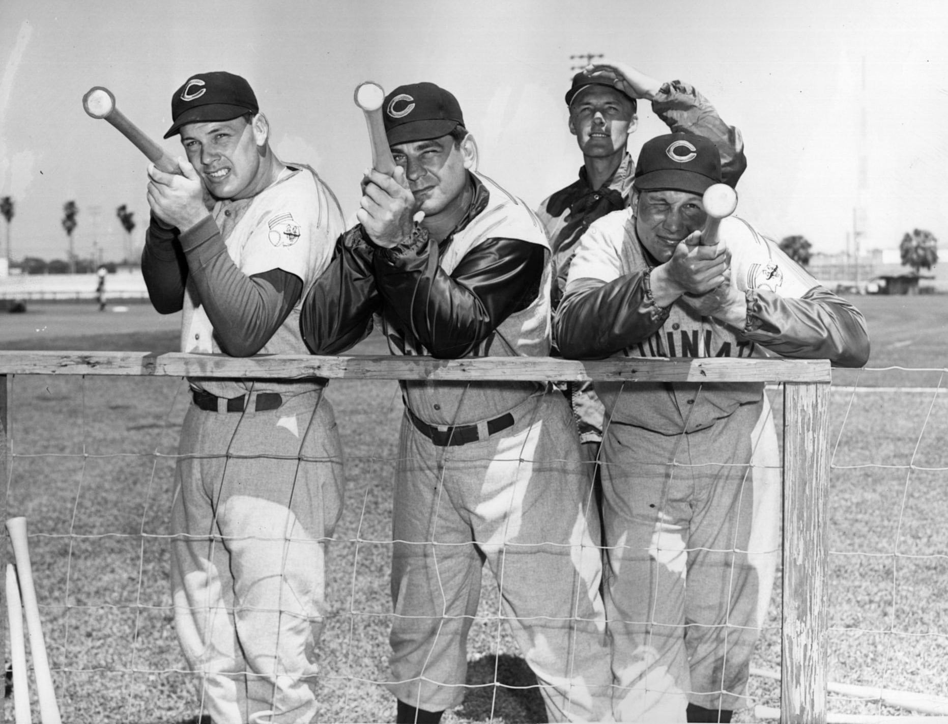 AP file photo of the Cincinnati Reds, shown with their batting artillery at the club's spring training camp in 1956 at Tampa, Florida. Pictured from left to right are Gus Bell, Ted Kluszewski and Wally Post.