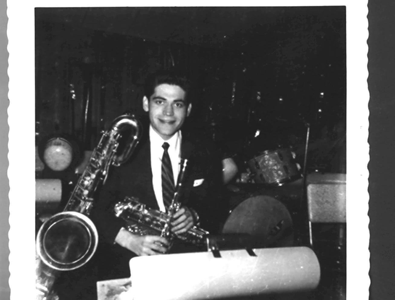 Arthur Buzzy James Ernst of Covington, Ky. is shown playing in a band.