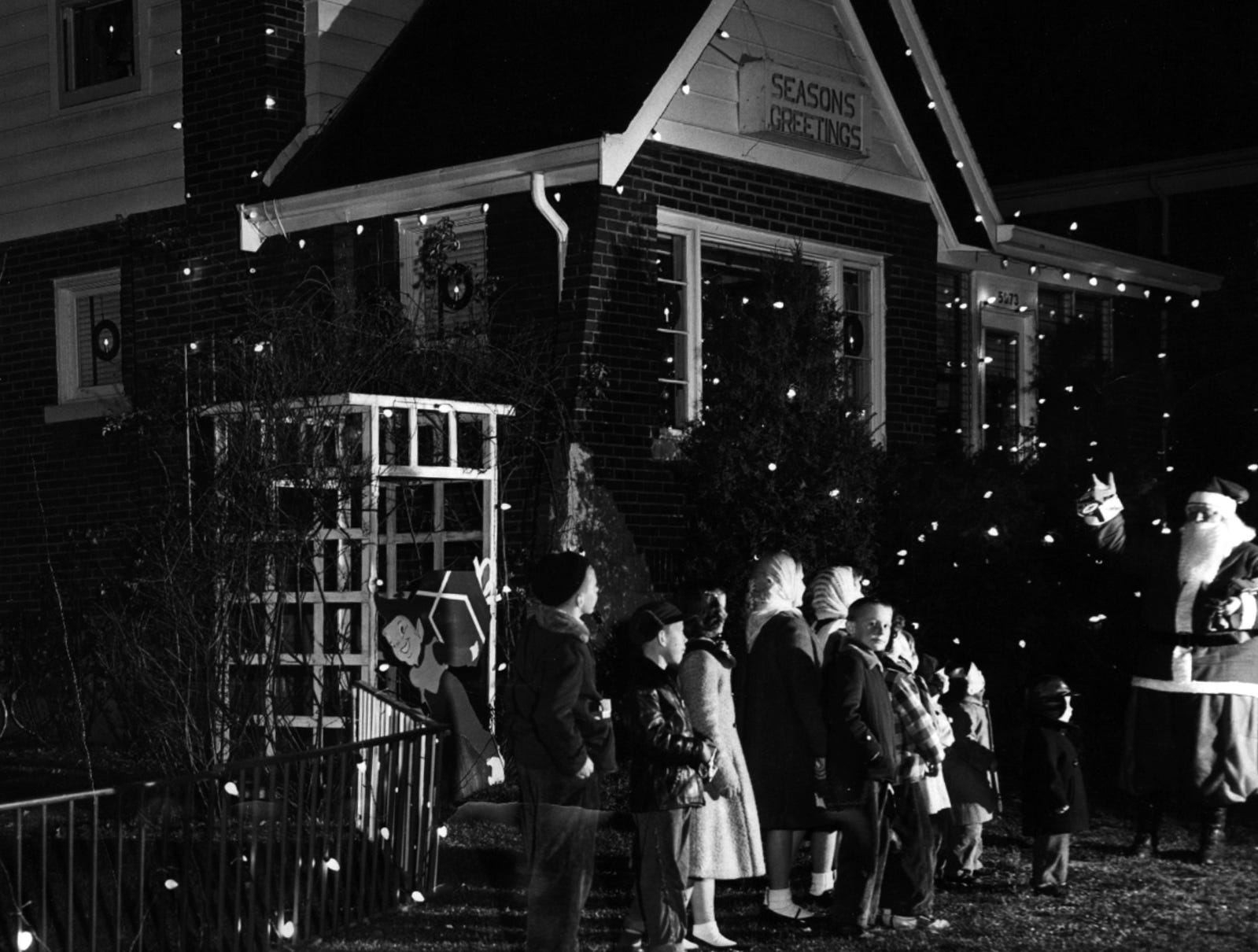 For the third consecutive year, the Christmas, display at the Herman B. Pownall home, 5073 Casa Loma, is attracting Cincinnati youngsters and adults in 1956. The decorations, which contain 1256 bulbs, were put up by Pownall and his son Robert.