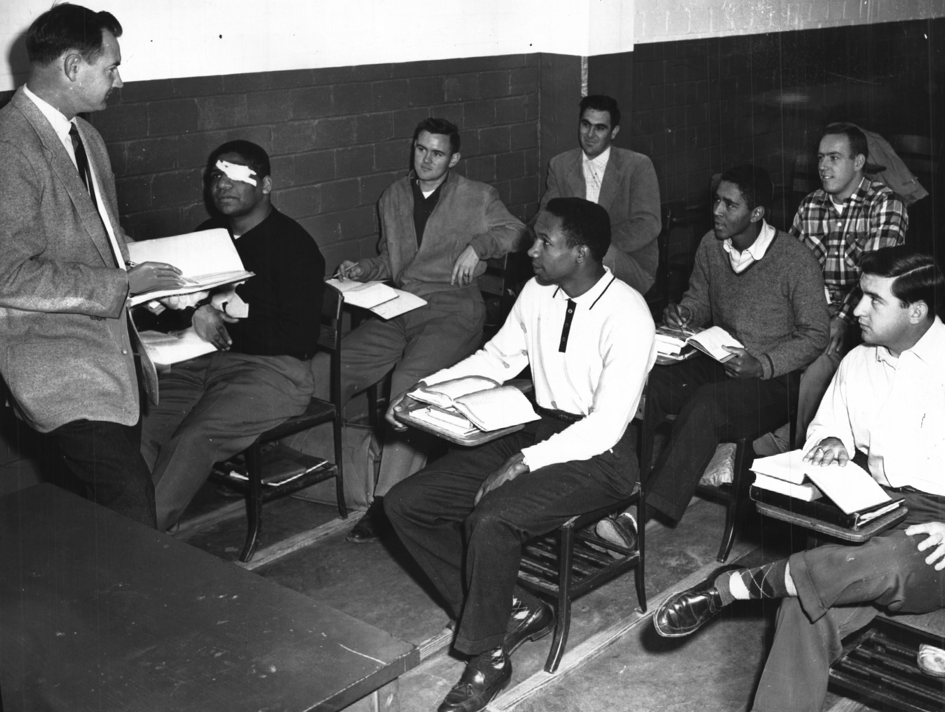 Frank Robinson, seated, center foreground, is shown taking classes at Xavier University while playing his rookie season with the Cincinnati Reds in 1956.