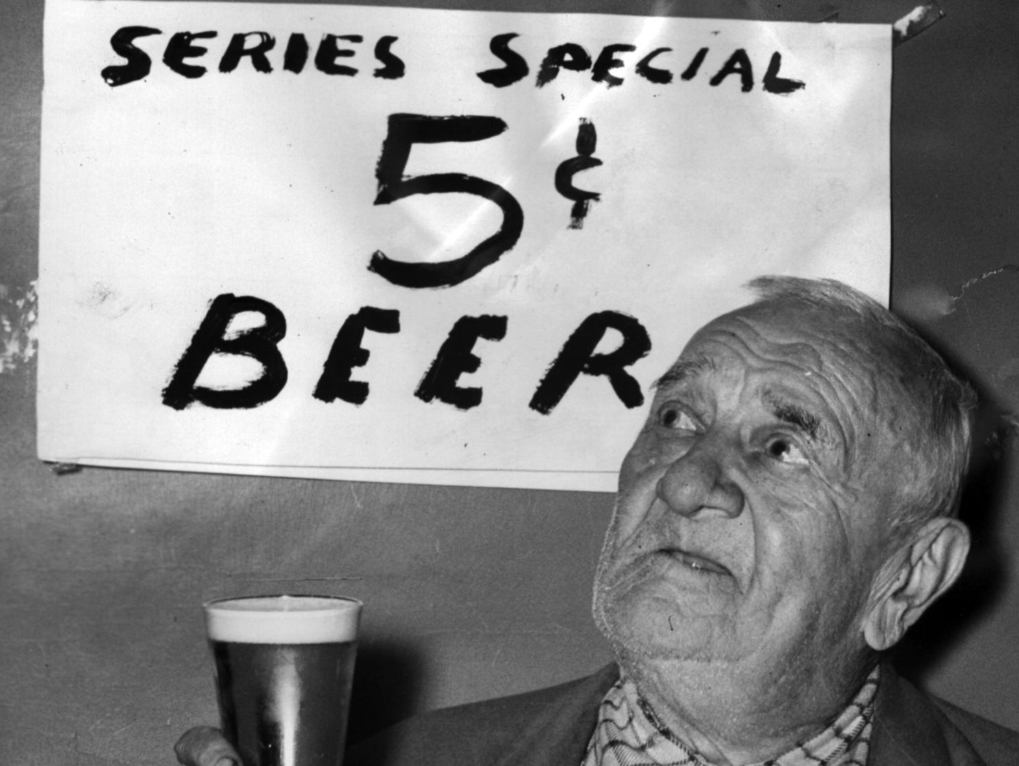 Must be the nickel beer! It may have been the Yankee win or the five-cent beer - or both - that etched the intent expression on the face of Fred W. Eichler, 85, as he watched television at the Z-Bar, 3662 Vine St. The aged man, of 3536 Vine St., was one of dozens of regular patrons who watched the World Series in the bar, quaffing nickel beer - rare indeed, these days.