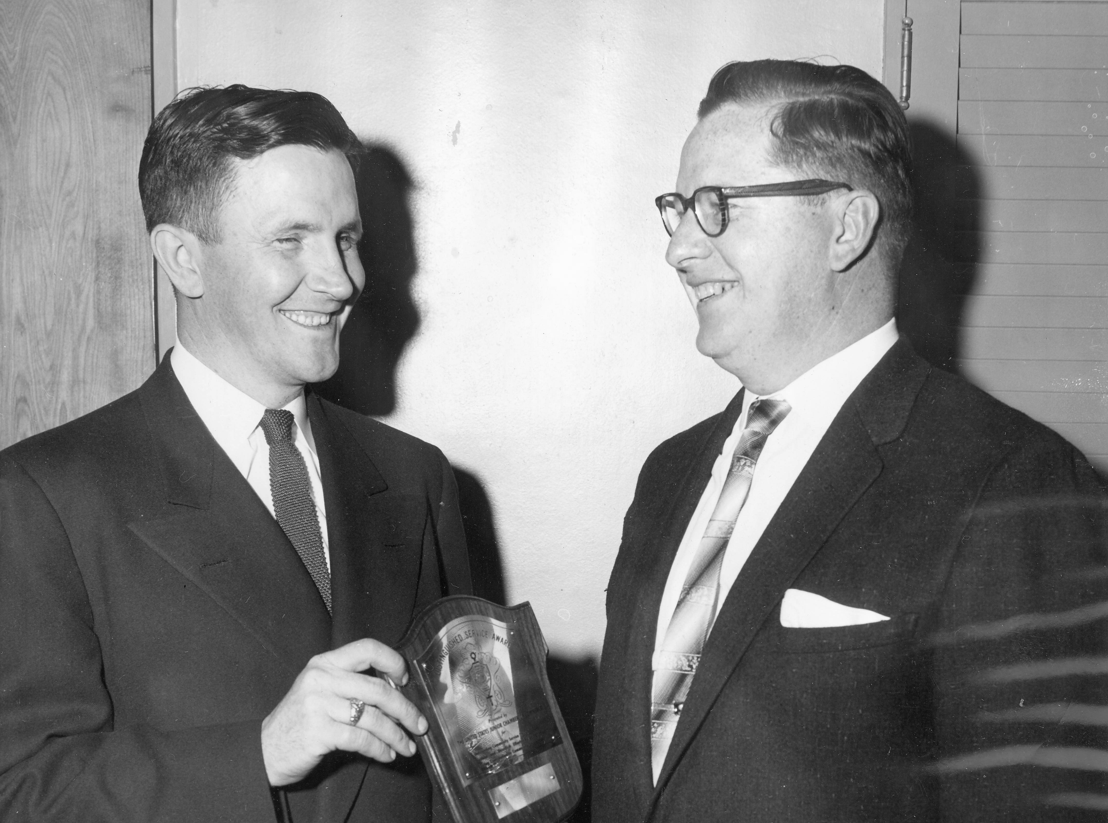 John J. O'Hara, left, was named 1956 man of the year by Kenton County Jaycees. Right, Avery Dotson, the 1955 man of the year, made the presentation.