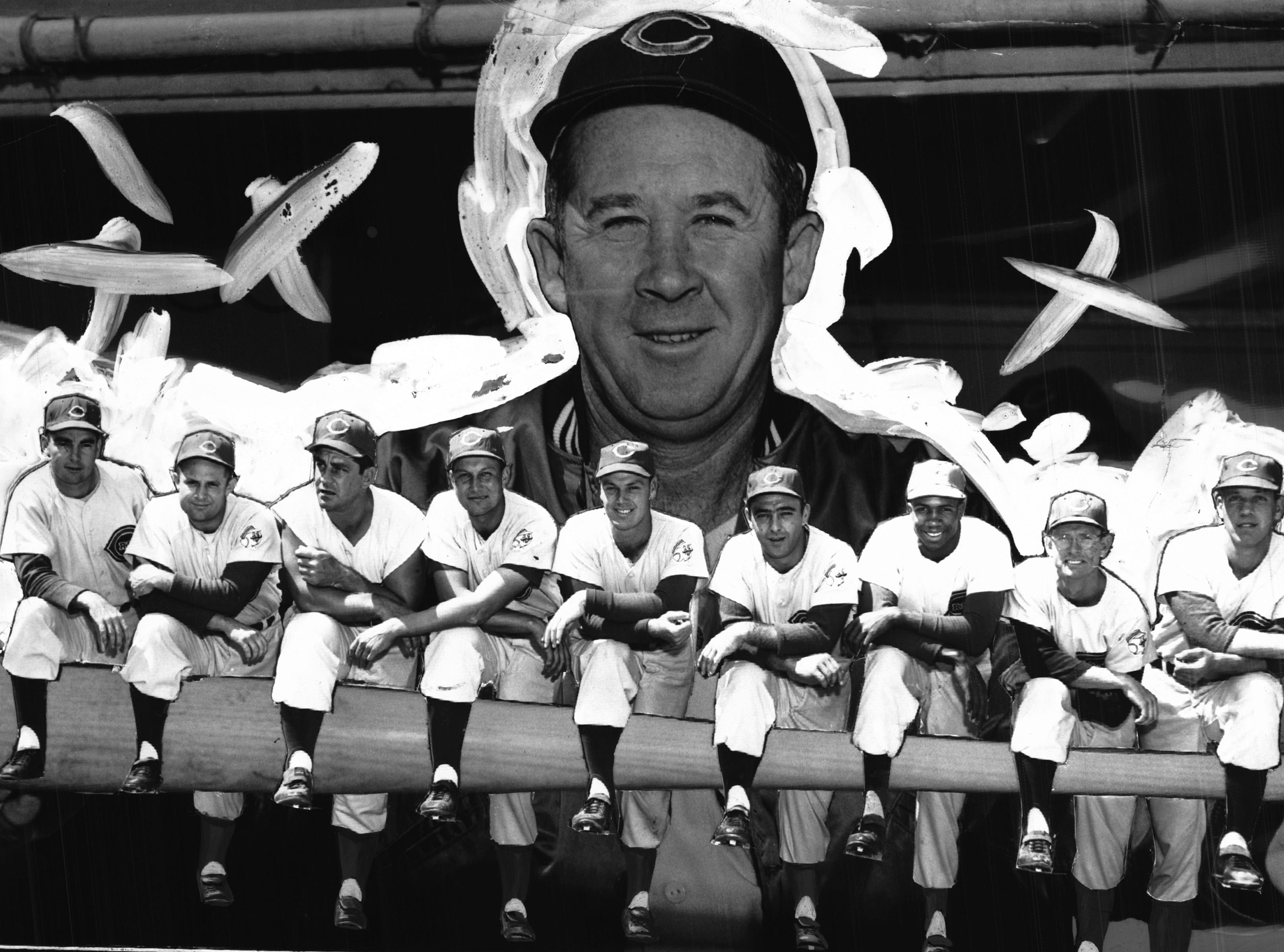 Manager Birdie Tebbetts proudly holds the 1956 Cincinnati Reds starting line-up in his hands. Left to right, Johnny Temple, 2b; Smoky Burgess, c; Ted Kluszewski, 1b; Wally Post, rf; Gus Bell, cf; Ray Jablonski, 3b; Frank Robinson, 1f; Roy McMillan, ss; and Joe Nuxhall, p. The Enquirer/Allan Kain
