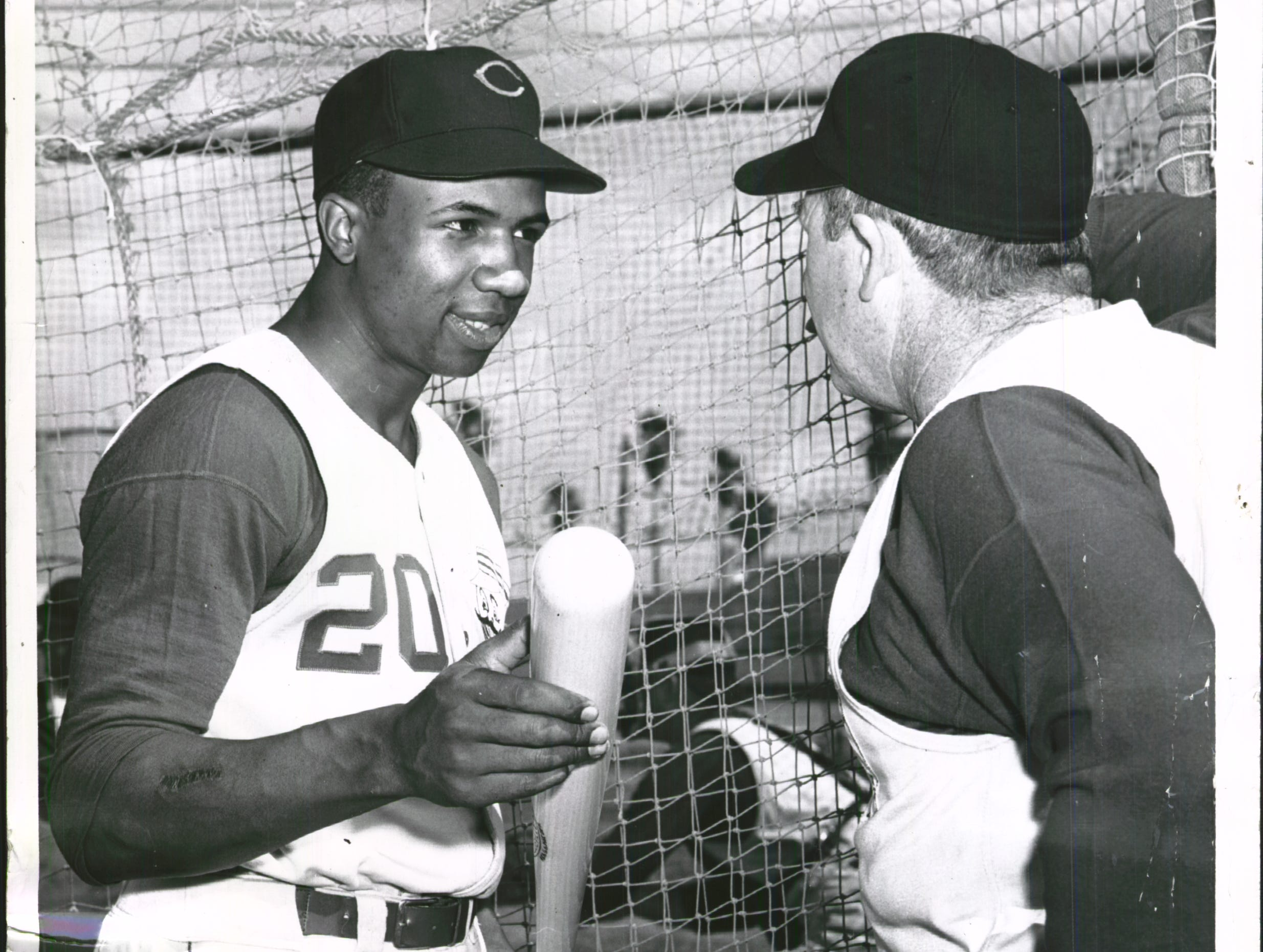 Frank Robinson, left, chatted with his manager, Birdie Tebbetts, before taking his turn in the hitter's cage at the Reds' spring training camp at Tampa, Fla.