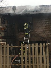 Firefighters from neighboring departments helped Colerain Township on the scene of a two-alarm fire that left eight families homeless.