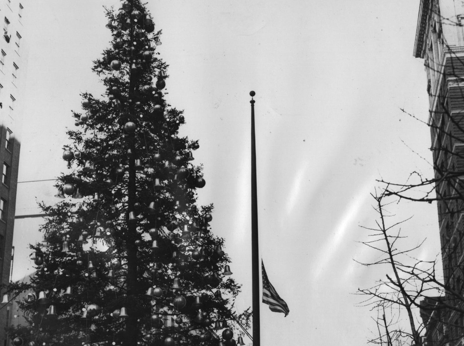 The American flag on Fountain Square stood at half staff yesterday, 12/10/56, as Cincinnatians observed Human Rights Day - proclaimed by Mayor Charles Taft at a time to pay tribute to the Hungarian patriots fighting Russian rule.