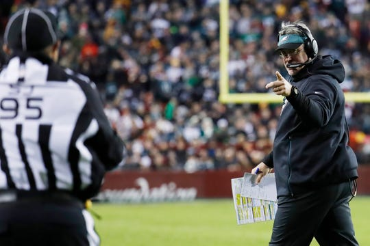 Philadelphia Eagles head coach Doug Pederson gestures toward field judge James Coleman (95) against the Washington Redskins in the second quarter at FedEx Field.
