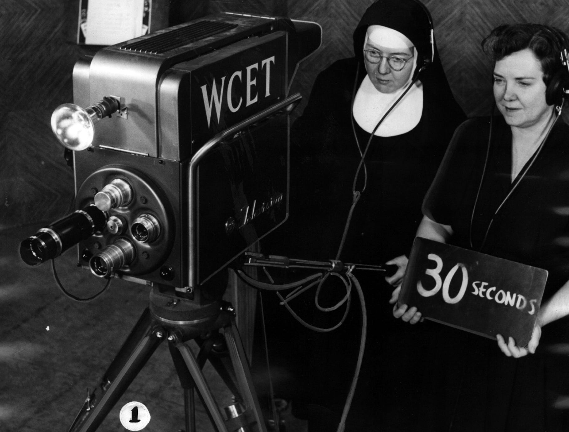 Sister Mary Cordelia of Mother of Sorrows High School in Roselawn, left, and Mrs. Eldridge Faulkner, radio-TV chairman of the Hamilton County Council of Parent-Teacher Associations, take charge of a studio camera for first-hand study of picture pick-up in a WCET-TV studio Feb. 28, 1956.