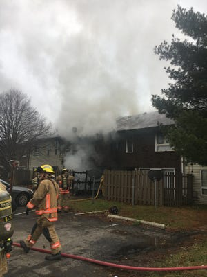 Colerain Township firefighters battle a fire at the Ashley Woods Apartments.