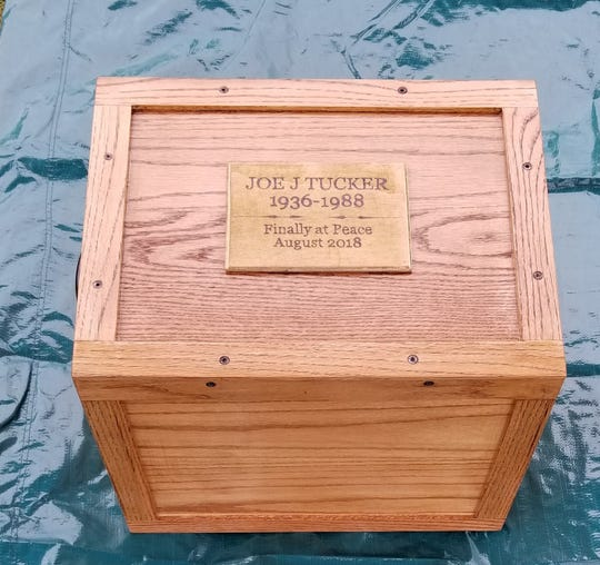 Suzanne Potts' husband constructed a box to contain the skull and hand of her father, which was buried with the rest of his body in Stewart County.