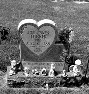 The headstone for Joe Tucker, who was shot and killed in Idaho in 1988.