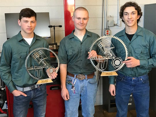 Left to right with their trophies from the UTI Top Tech Challenge are Hunterdon County Polytech's Drew Thomas, Patrick Willey and Austin Tarby.