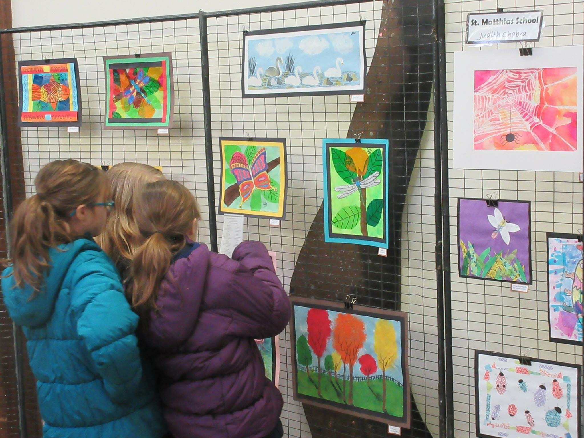 Children examine the works of other young artists at the Children's Environmental Art Show, which will be held at the Environmental Education Center from Monday, Jan. 7, to Sunday, Feb. 3.