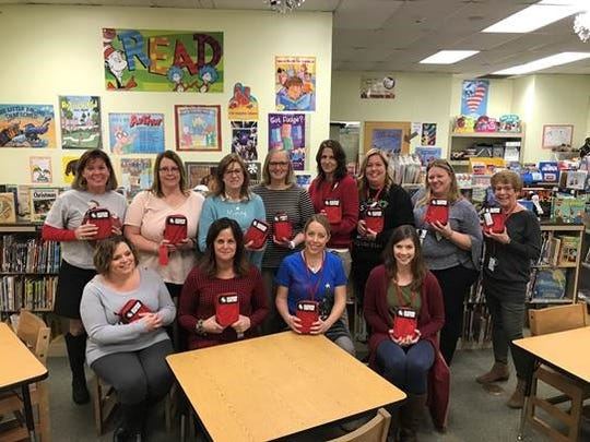 Pictured Holland Township Elementary School teachers pose with the bleeding control kits that will be in their classrooms. Back row (from left to right) - Cathy O'Rourke, Nicole Carr, Robin Nugent, Debbie Croasdale, Janet Huber, Joyce Criss, Alea Wilt, and Chris Regan. Front row (from left to right)- Joelle Pursell, Amy Brown, Liz Vocke, and Amber Lazier.