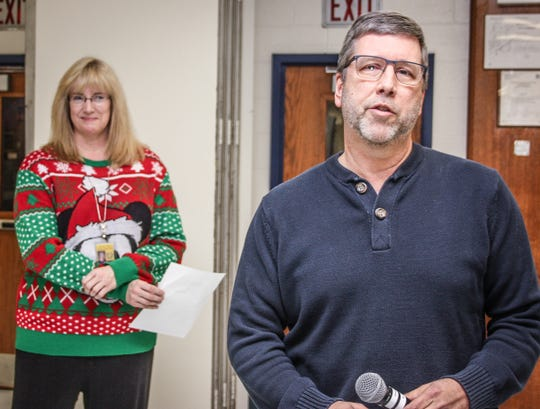 Del Val Teacher of the Year Rod Jensen graciously accepts the honor at the close of the Dec. 17 faculty meeting, after it was announced by Principal Adrienne Olcott, wearing a sweater appropriate to the ensuing party.