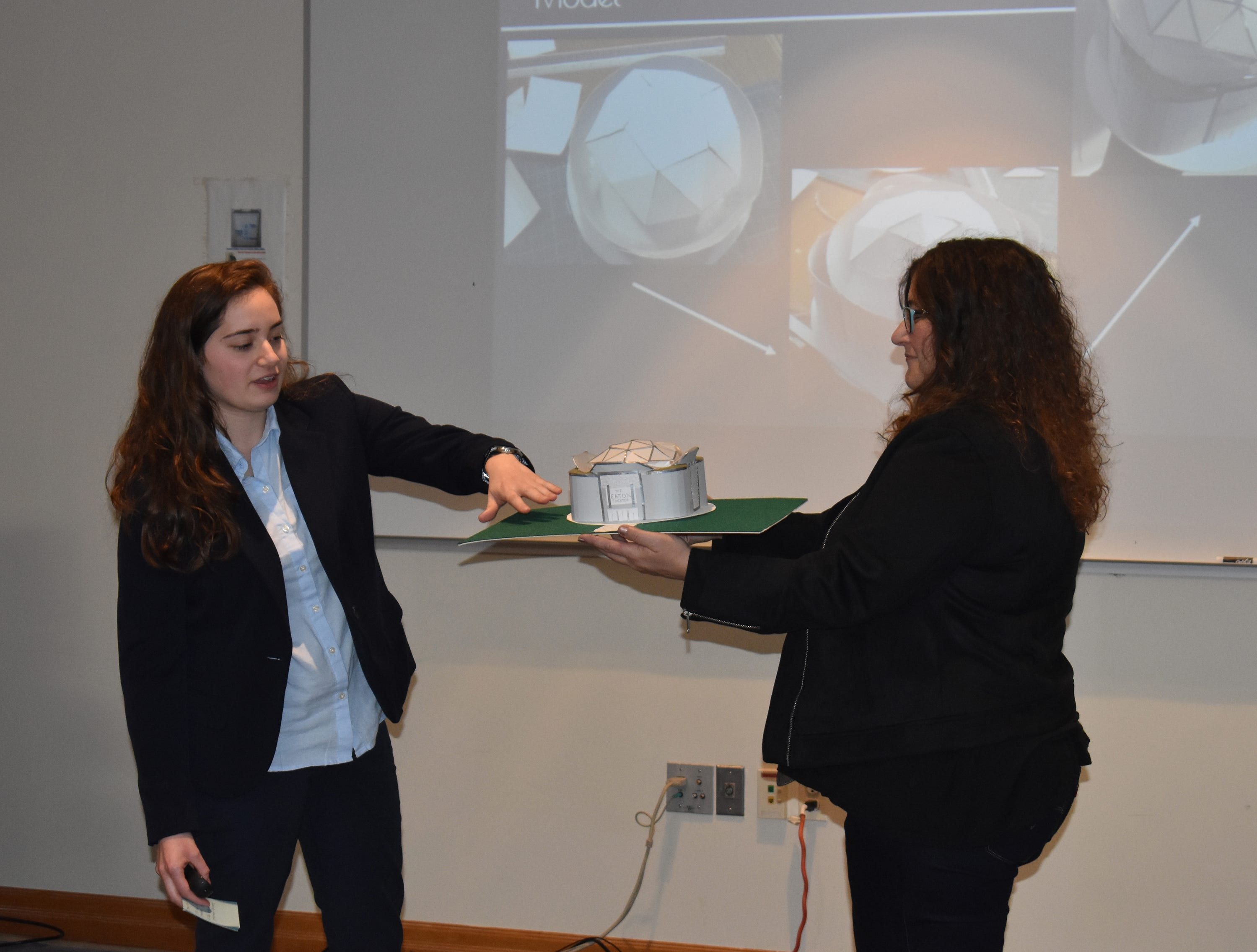 "RVCC Honors College student Kathleen Stavole of Green Brook, left, presents her model theatre design as part of her Capstone Course project, ""Modern Aesthetics in Theatre Design,"" at a Dec. 11 symposium. She is joined by her faculty advisor, Adjunct Assistant Professor Lisa Deo."