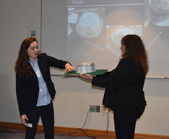 """RVCC Honors College student Kathleen Stavole of Green Brook, left, presents her model theatre design as part of her Capstone Course project, """"Modern Aesthetics in Theatre Design,"""" at a Dec. 11 symposium. She is joined by her faculty advisor, Adjunct Assistant Professor Lisa Deo."""