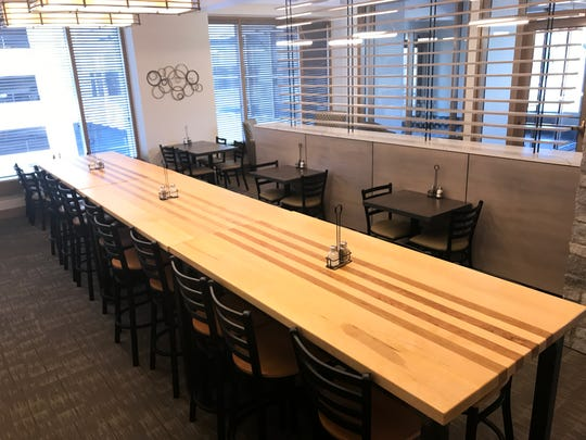A 20-person communal table runs the length of the dining room at the new Main Street Cafe & Bakery.