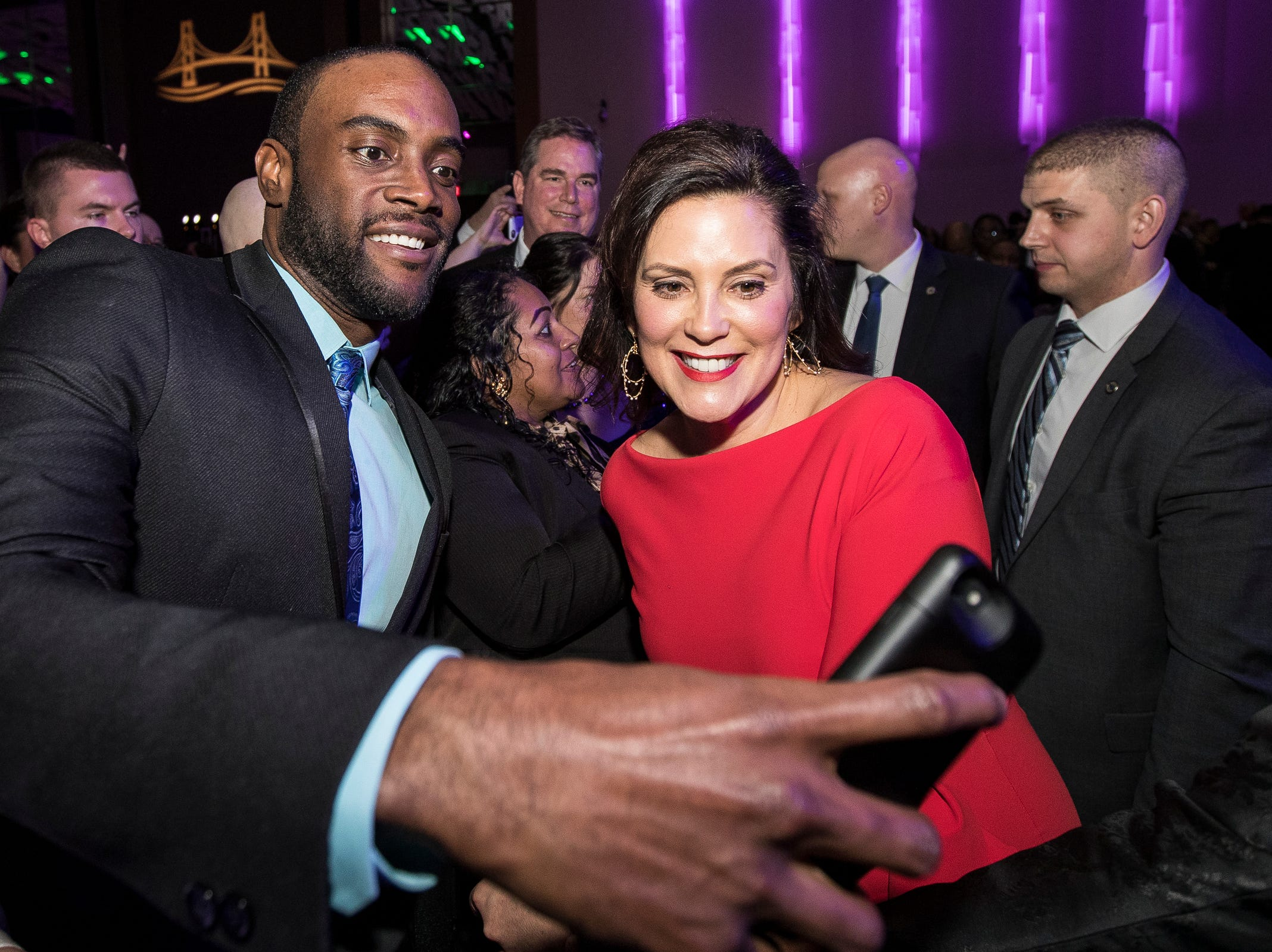 Detroit attorney Maurice Davis talks a selfie with Governor Gretchen Whitmer during the inaugural ball at Cobo Center in Detroit on Tuesday, Jan. 1, 2019.