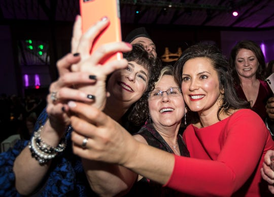 Governor Gretchen Whitmer takes a selfie with Lisa Zimmer of Northville, left, and Laura Humphries of Plymouth during the inaugural ball at Cobo Center in Detroit, Tuesday, Jan. 1, 2019.