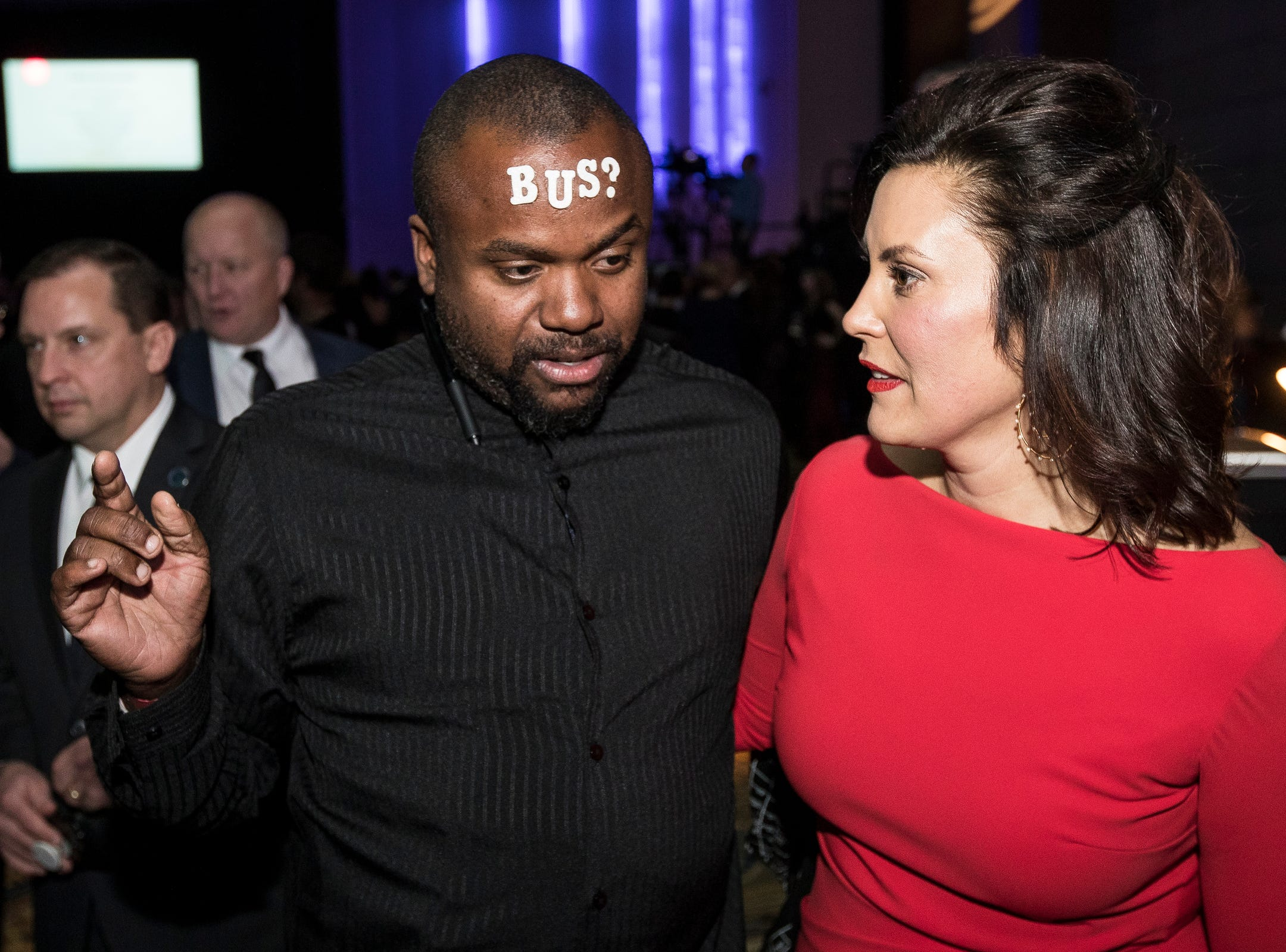 Michael Cunningham of Detroit, a bus advocate talks to Governor Gretchen Whitmer during the inaugural ball at Cobo Center in Detroit on Tuesday, Jan. 1, 2019.