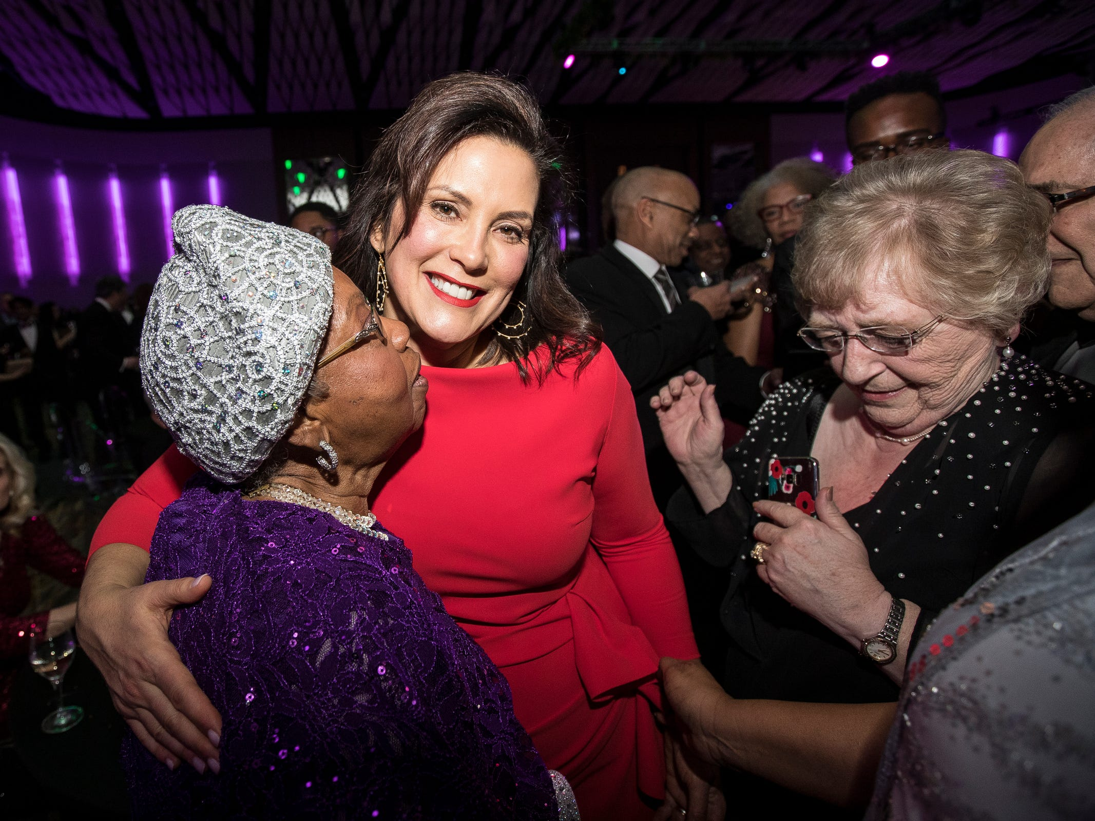 Former state representative Alma Stallworth hugs Governor Gretchen Whitmer during the inaugural ball at Cobo Center in Detroit on Tuesday, Jan. 1, 2019.
