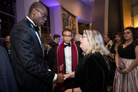 Lieutenant governor Garlin Gilchrist II shakes hands with Patricia Harris of Westland during the inaugural ball at Cobo Center in Detroit, Tuesday, Jan. 1, 2019.