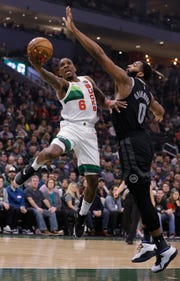 Milwaukee Bucks' Eric Bledsoe (6) drives against Detroit Pistons' Andre Drummond during the first half of an NBA basketball game Tuesday, Jan. 1, 2019, in Milwaukee.