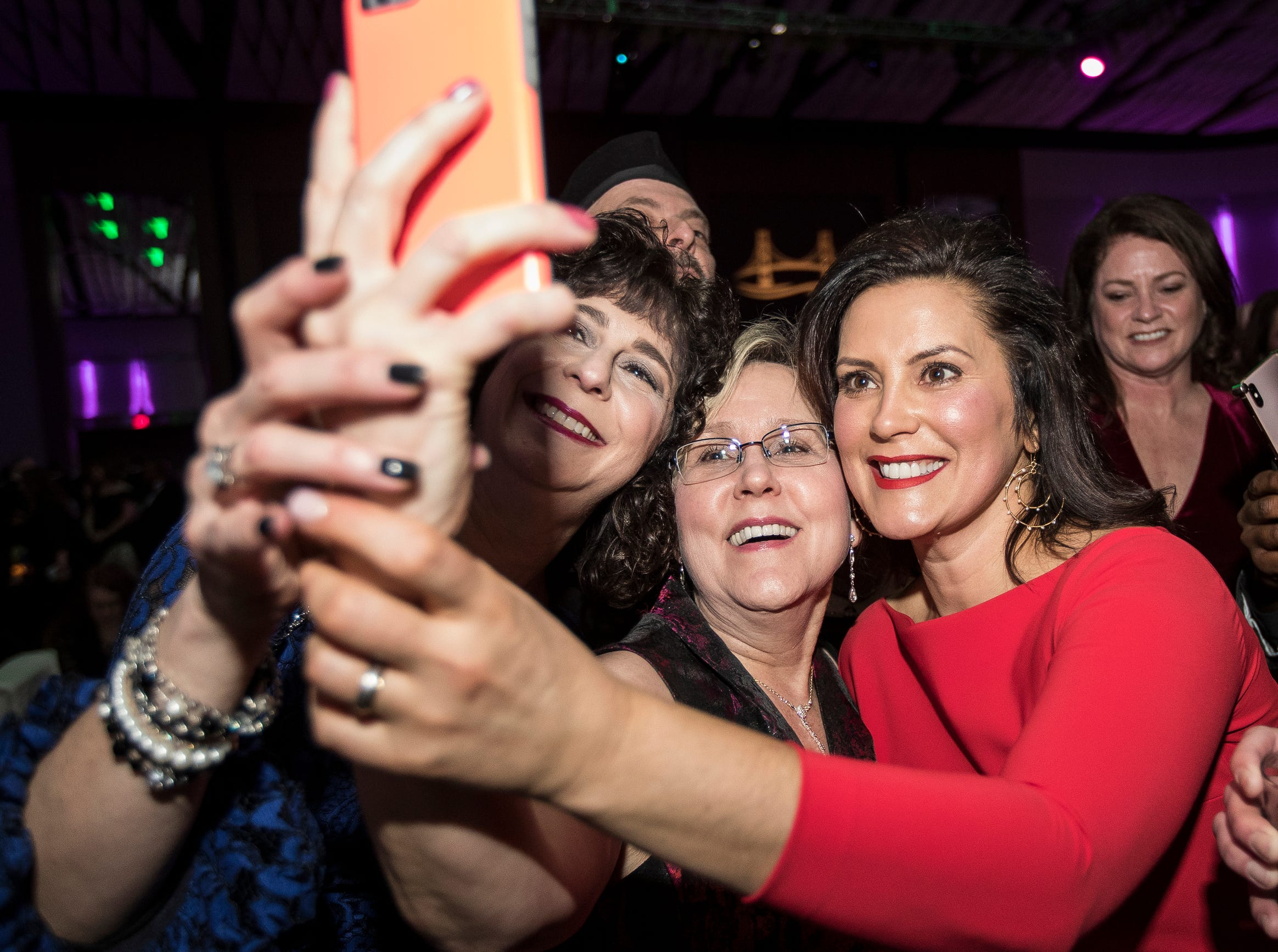 Governor Gretchen Whitmer takes a selfie with Lisa Zimmer of Northville, left, and Laura Humphries of Plymouth during the inaugural ball at Cobo Center in Detroit on Tuesday, Jan. 1, 2019.