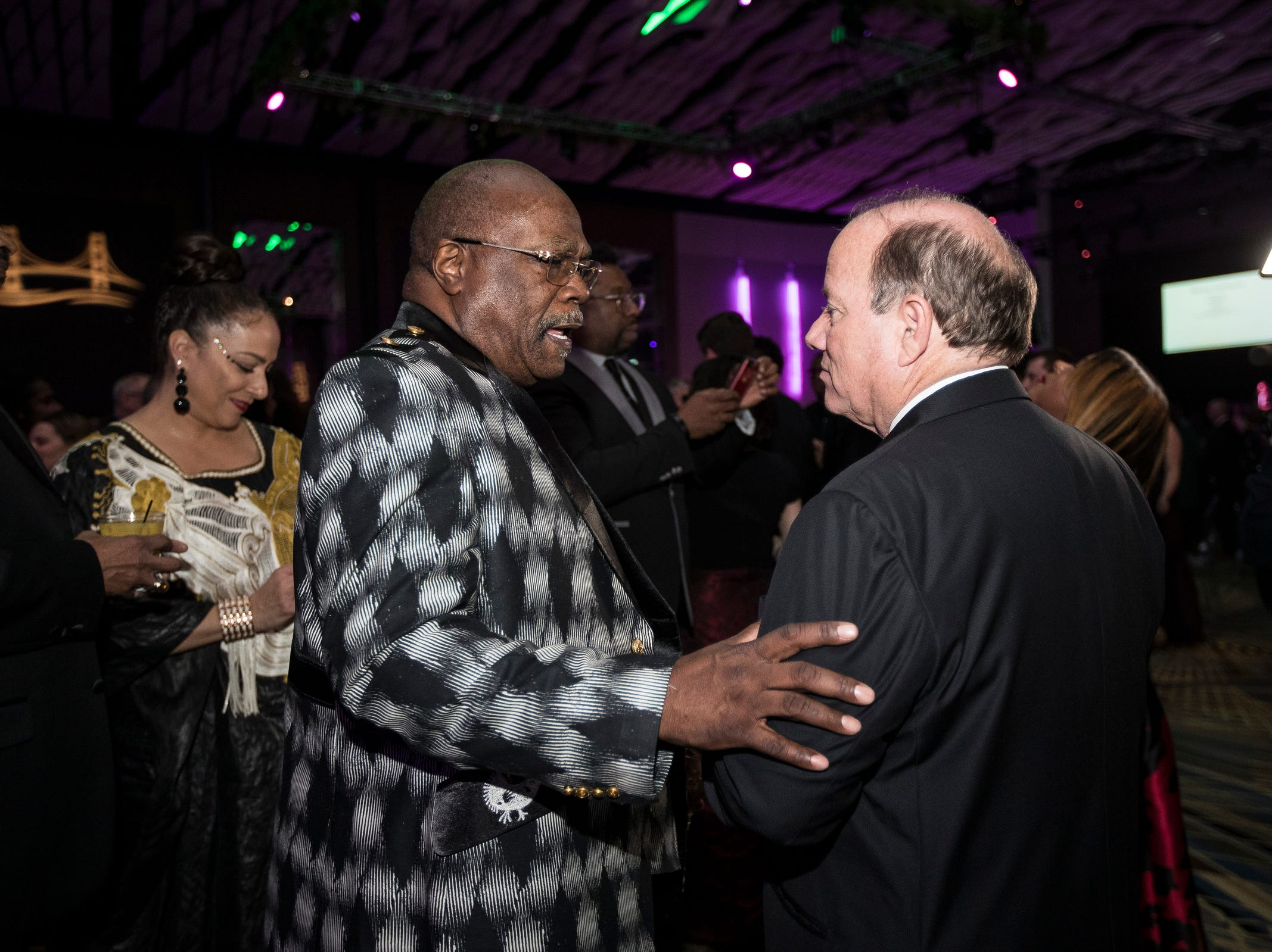 Rev. Wendell Anthony talks to Detroit mayor Mike Duggan during Governor Gretchen Whitmer's inaugural ball at Cobo Center in Detroit on Tuesday, Jan. 1, 2019.