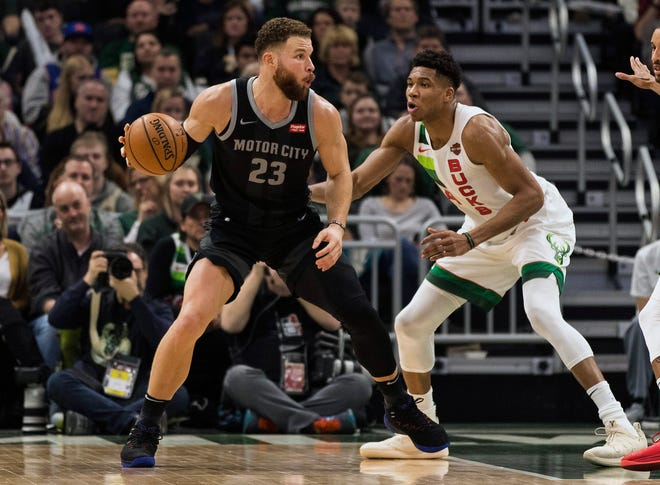 Pistons forward Blake Griffin (23) works for a shot against Milwaukee Bucks forward Giannis Antetokounmpo (34) during the second quarter at Wisconsin Entertainment and Sports Center.