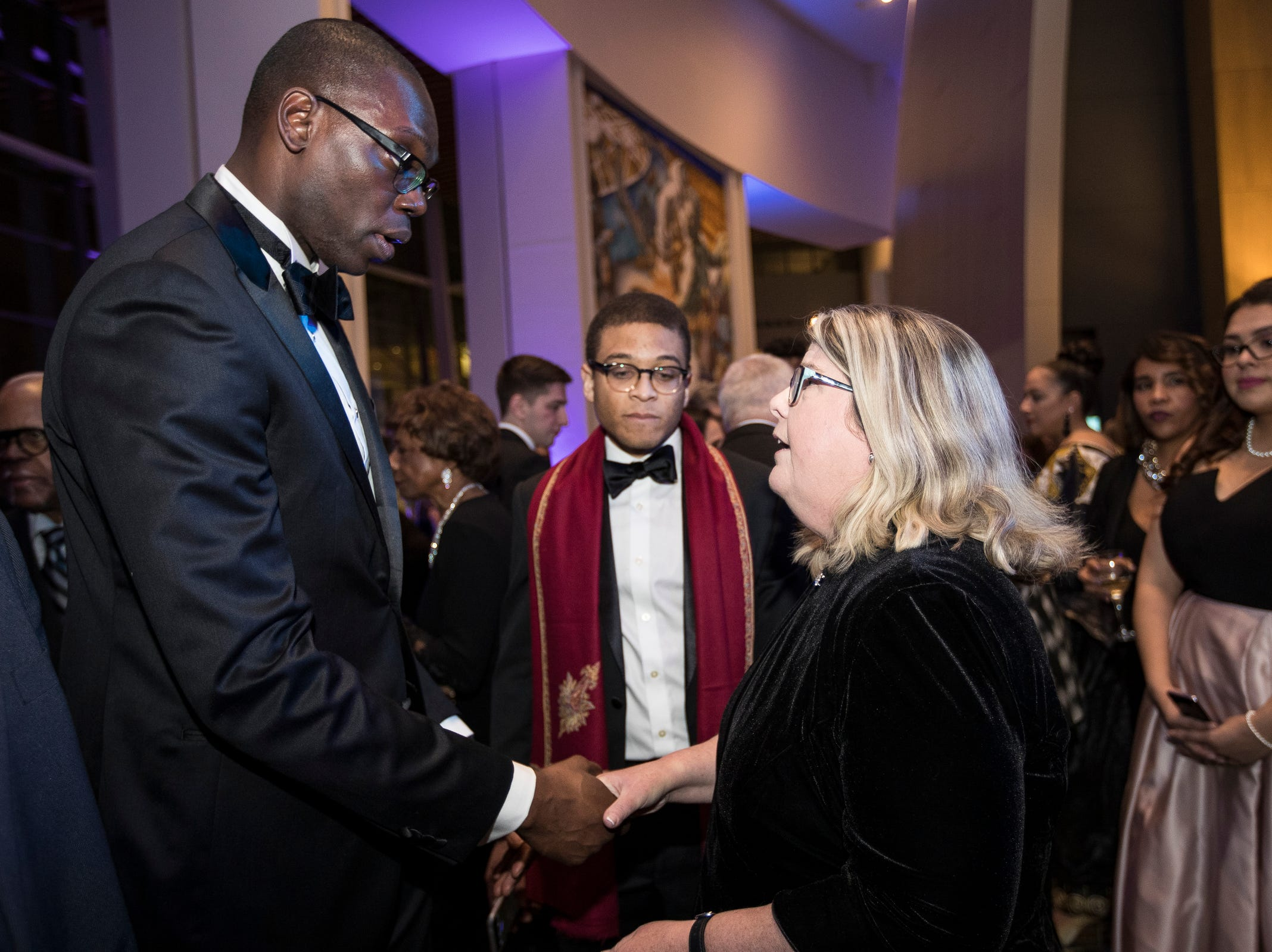Lieutenant governor Garlin Gilchrist II shakes hands with Patricia Harris of Westland during the inaugural ball at Cobo Center in Detroit on Tuesday, Jan. 1, 2019.