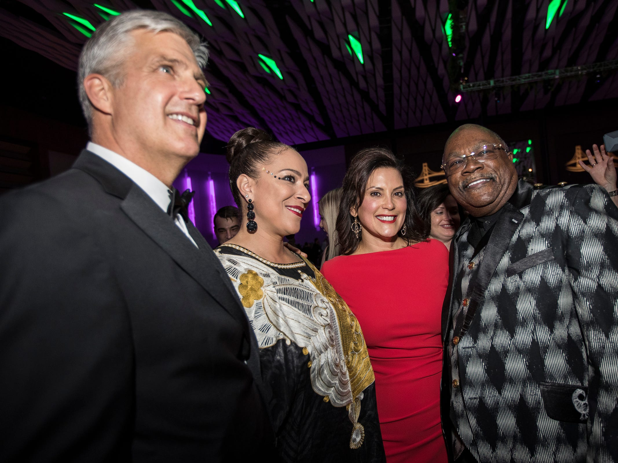 Governor Gretchen Whitmer, center right, and her husband Marc Mallory, far left, pose for a photo with Rev. Wendell Anthony, far right, and his wife Monica Anthony during the inaugural ball at Cobo Center in Detroit on Tuesday, Jan. 1, 2019.