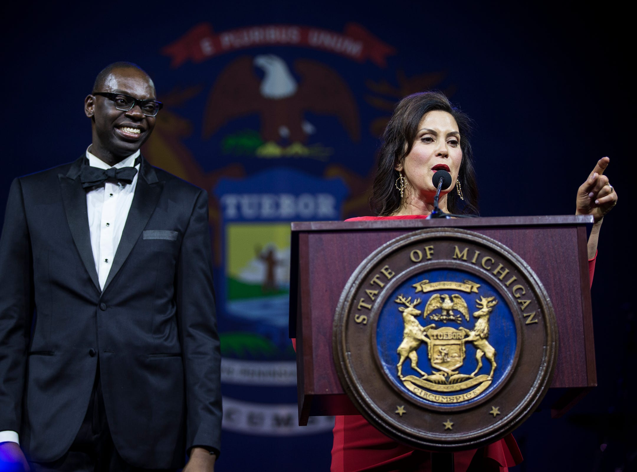 Governor Gretchen Whitmer speaks next to Lieutenant governor Garlin Gilchrist II during the inaugural ball at Cobo Center in Detroit on Tuesday, Jan. 1, 2019.